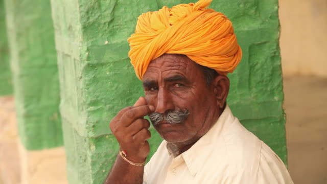 rajasthani senior men showing masculinity, jaisalmer, rajasthan, india - masculinity stock videos & royalty-free footage