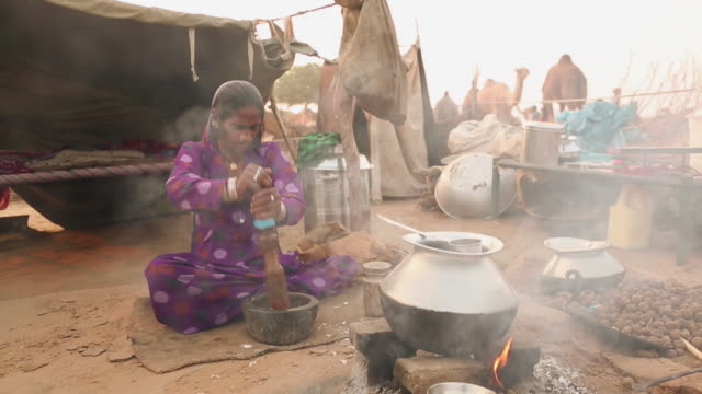 Rajasthani woman cooking food, Rajasthan, India