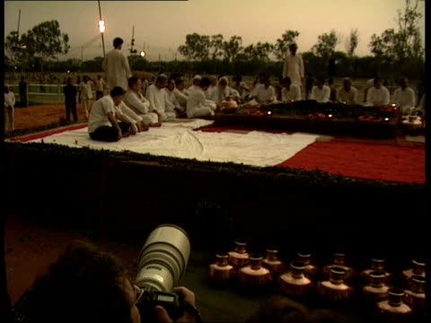 New Delhi Shakti Sthal Jamuna River THROUGHOUT*** Various shots of Rahul Gandhi and others sitting around urn and funeral pyre NBC camera GV Scene...