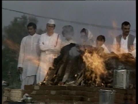 rajiv gandhi watches his mother indira gandhi's funeral pyre burn delhi 1984 - indira gandhi stock videos & royalty-free footage