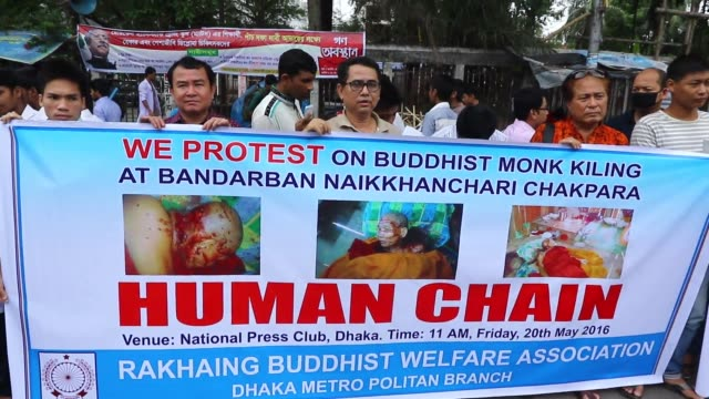 Rakhine Buddhist Welfare Association forms a human chain in front of the Jatiya Press Club in Dhaka demanding the arrest of the criminals who killed...