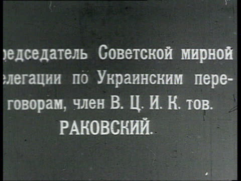 rakovsky taking cigarette and smoking accompanied by man / russia - 1918 stock videos and b-roll footage