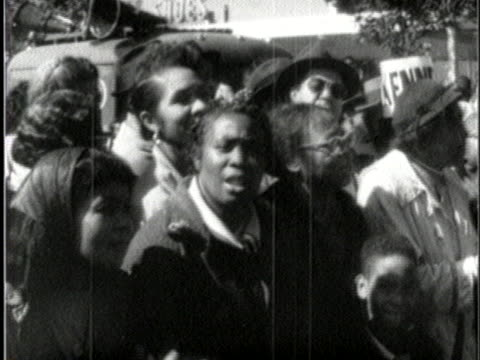 rally attendees cheer as presidential candidate u.s. senator john f. kennedy of massachusetts pledges to promote education for blacks. - employment issues stock videos & royalty-free footage
