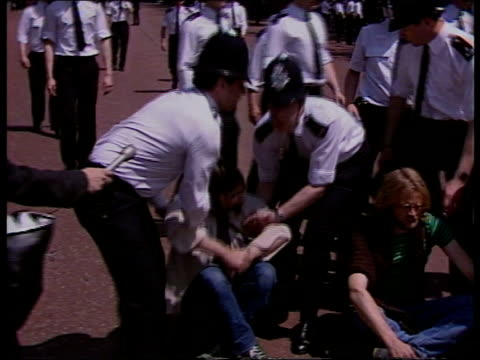 ; c) england: london: lamcaster house: ext sit down demo at lancaster house policeman speaking through megaphone the mall: sit down demo in the mall... - political rally stock videos & royalty-free footage