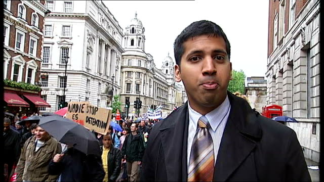 rally campaign for illegal migrant worker rights; protesters along during rally reporter to camera raining protesters along in rain trafalgar square:... - cormac murphy o'connor stock videos & royalty-free footage