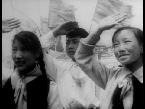 rally celebrating the crushing of the rebellion is held in lhasa / chinese flag raised and saluted / speeches are made and applause is given - 1959 stock videos & royalty-free footage