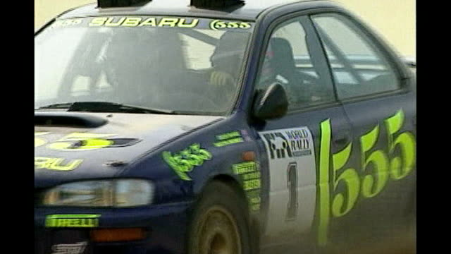 rally driver colin mcrae and son killed in helicopter crash; date and location unknown subaru 555 car driven by mcrae slow motion mcrae celebrating... - subaru stock videos & royalty-free footage