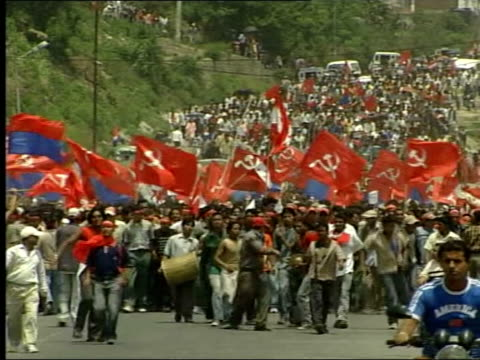 rally in kathmandu following king gyanendra's announcement of reinstatement of parliament ext thousands of demonstrators along carrying red hammer... - hammer stock videos & royalty-free footage