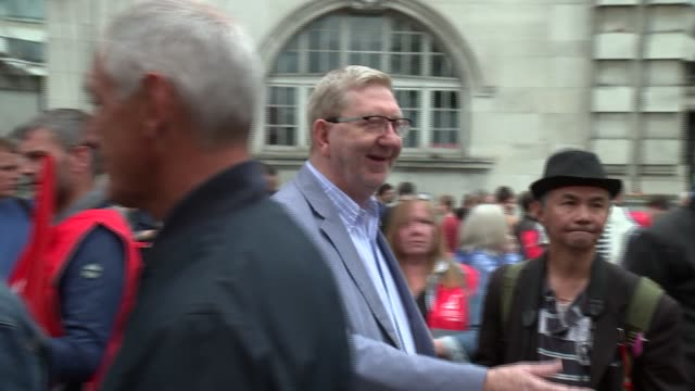 GVs and interviews ENGLAND London Embankment Len McCluskey chatting with people Len McCluskey interview SOT Len McCluskey with Unite the Union banner
