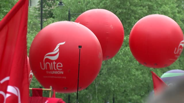 GVs and interviews ENGLAND London Embankment Unite the Union balloons / UNISON union balloons / antiausterity and trade union demonstrators along...