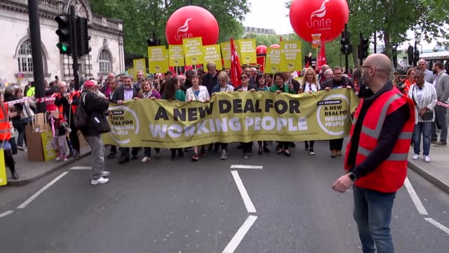 GVs and march to Hyde Park ENGLAND London Embankment Various of people holding 'A New Deal for Working People' banner / protesters with balloons...