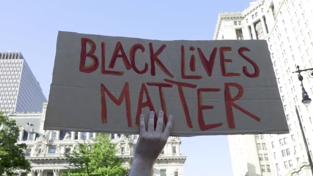 stockvideo's en b-roll-footage met rally in support of families of black people killed by police 15th consecutive day of protest sparked by the death of george perry floyd jr an... - black lives matter
