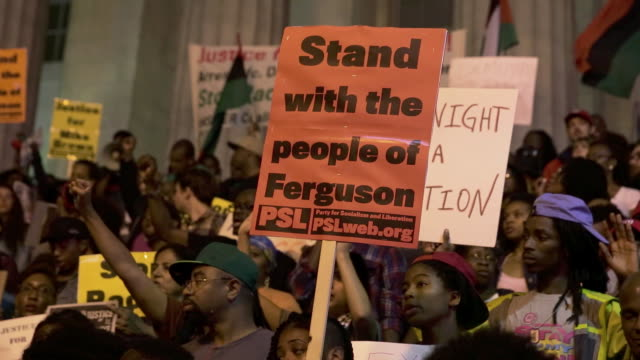 rally in support of michael brown in the chinatown area of washington dc - western script stock videos & royalty-free footage