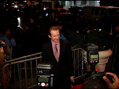 ralph fiennes and radio man at the merchant ivory's 'the white countess' world premiere at the paris theatre in new york, new york on november 21,... - レイフ・ファインズ点の映像素材/bロール