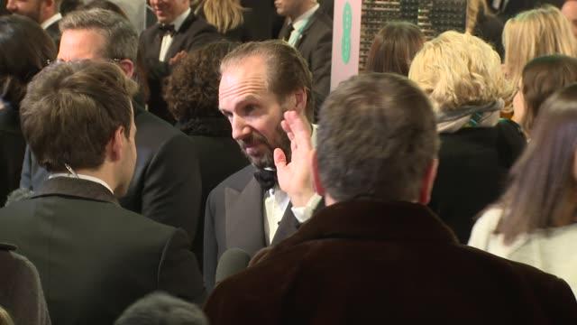 ralph fiennes at the ee british academy film awards , 8th february, london, england - レイフ・ファインズ点の映像素材/bロール