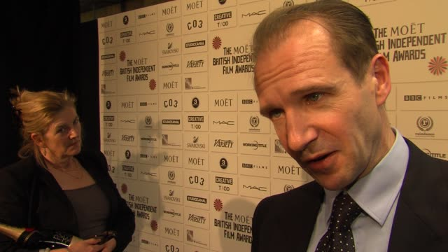ralph fiennes on directing, supporting independent films at the 14th moet bifas at old billingsgate market on december 04, 2011 in london, england - レイフ・ファインズ点の映像素材/bロール