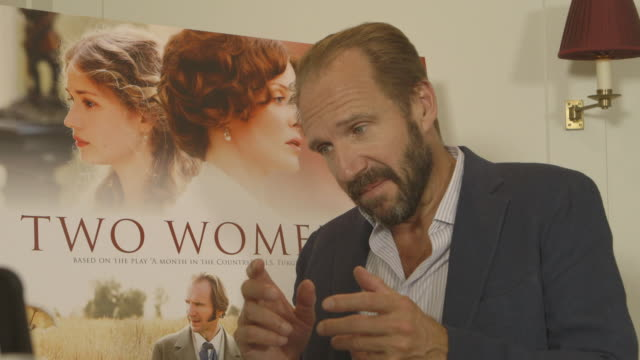 ralph fiennes on new film 'two women' and learning russian for the role at 'two women' gala screening, 13th september, london, england. - レイフ・ファインズ点の映像素材/bロール
