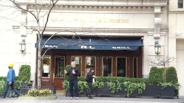 a ralph lauren location with bar and grill signage on awning in chicago il on october 30 2017 photographer christopher dilts shots wide shot of... - awning stock videos & royalty-free footage