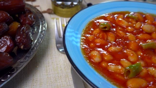 ramadan meal with pita, bowl, baked beans and rice. - ramadan stock videos & royalty-free footage