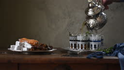 Ramadan mint tea and cakes preparation of meal in kitchen slow motion