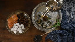 Ramadan mint tea and cakes preparation of meal in kitchen