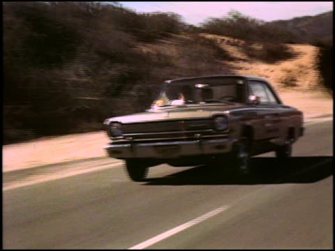 ws amc rambler american 440 passing by on a desert highway / ws reverse angle of rambler passing by the opposite direction on the same highway / ws... - pan american highway stock videos and b-roll footage