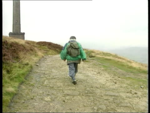 ramblers mass trespass halcombe moor cms benny looking out over moor cms benny along pan rl bv benny along away tgv housing alongside moor as mates... - trespassing stock videos & royalty-free footage