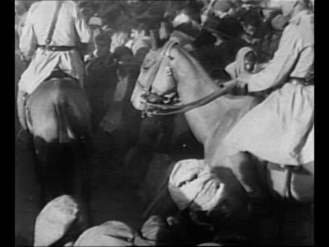 ramdas gandhi lights the funeral pyre of his father indian political leader mohandas k gandhi as crowds look on / men on horseback ride through... - mahatma gandhi stock videos & royalty-free footage