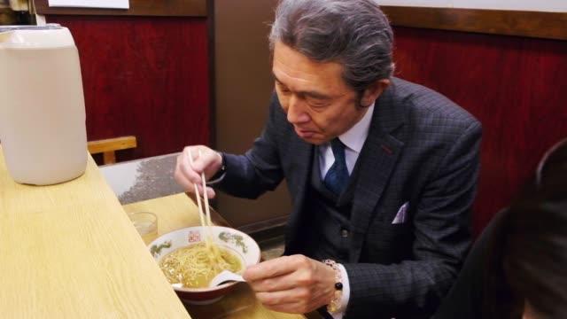 ramen shop in tokyo japan - mature men stock videos & royalty-free footage