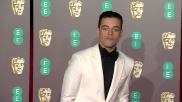rami malek poses for photos on red carpet at bafta film awards at royal albert hall - red carpet event stock videos & royalty-free footage