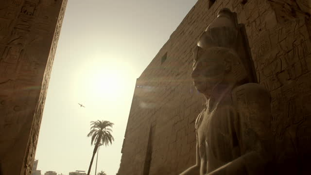 ramses ii monument with low sun - statue stock videos & royalty-free footage