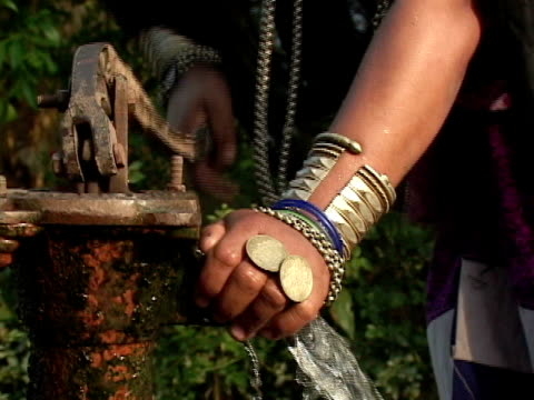 zi, ecu, rana tharu woman pumping water from well, terrain, nepal - water pump stock videos & royalty-free footage