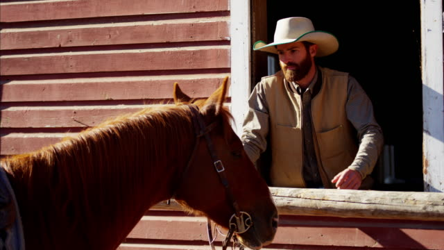 Ranch hand bonding with horse Dude Ranch USA