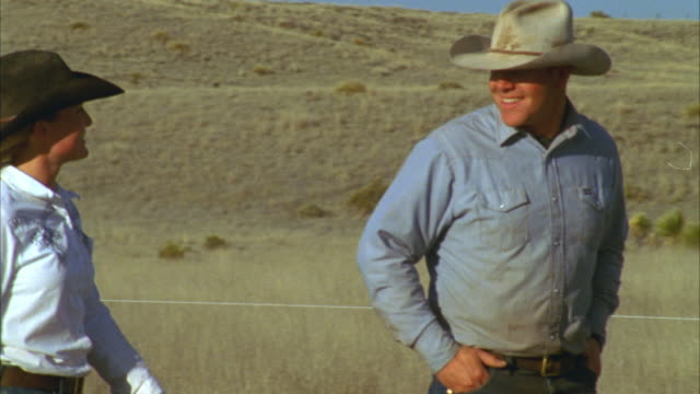 ms pan ranchers walking on ranch / marfa, texas, usa - rancher stock videos & royalty-free footage