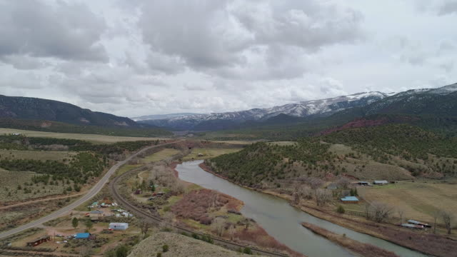 ranches in colorado mountains nearby mccoy and colorado river, in the early spring. aerial drone video with the backward camera motion. - ranch home stock videos & royalty-free footage