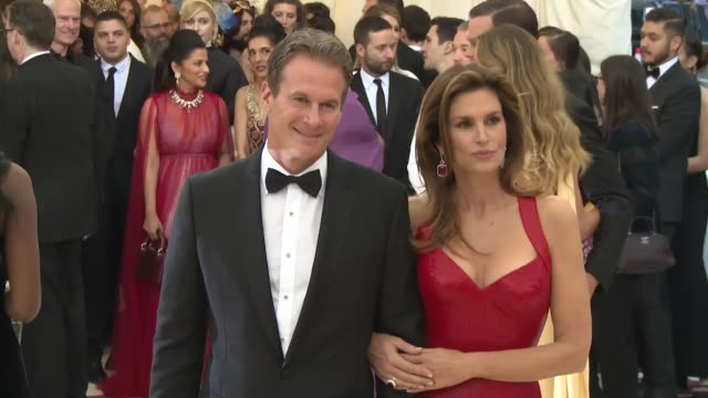 rande gerber and cindy crawford at heavenly bodies: fashion & the catholic imagination costume institute gala at the metropolitan museum of art on... - cindy crawford stock videos & royalty-free footage
