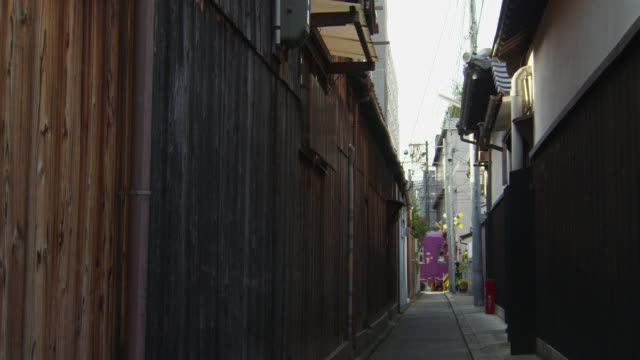 randen tram lines seen from alley - kyoto stock videos and b-roll footage
