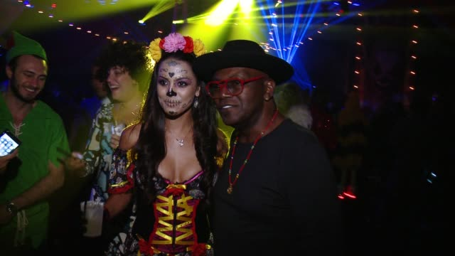 Randy Jackson and Raquel Pomplun at The Playboy Mansion on October 24 2015 in Los Angeles California