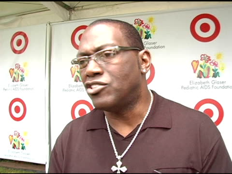 randy jackson on his thoughts on charity work for celebs on his summer plans and on the cause he and his wife spearheaded combating child obesity at... - アタイムフォーヒーローズ点の映像素材/bロール