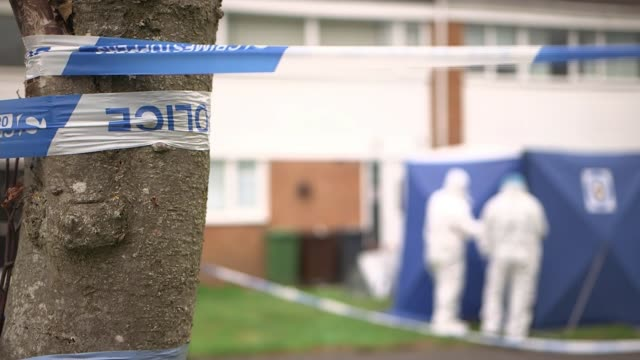 police hunt for suspect continues uk west midlands solihull police investigators at scene of murder / detective chief superintendent mark payne... - west midlands stock-videos und b-roll-filmmaterial