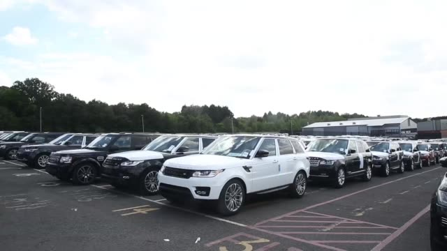 range rover and land rover automobiles are driven onto vehicle transporters ready for dispatch at the jaguar land rover plc assembly plant in... - plc stock videos & royalty-free footage