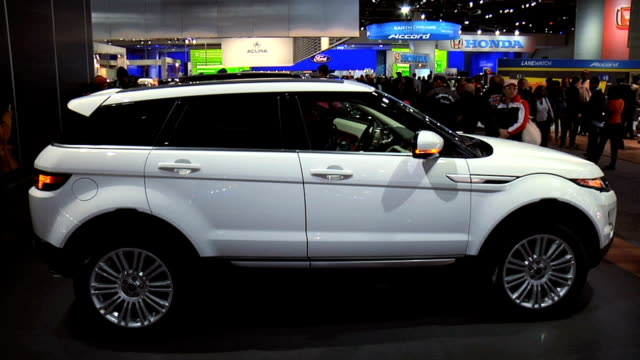"""stockvideo's en b-roll-footage met range rover evoque front end / rear three-quarter driver side view; evoque"""" badge on tail gate / passenger side profile 2013 land rover ranger rover... - sports utility vehicle"""