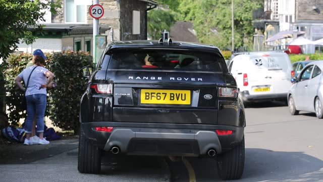 range rover, sometimes reffered to as 'chelsea tractors' has park on double yellow lines blocking the pavement at waterhead, ambleside, lake... - yellow stock videos & royalty-free footage