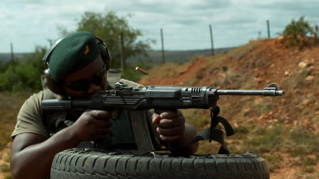 ranger fires rifle slow motion - south africa - rifle stock videos & royalty-free footage