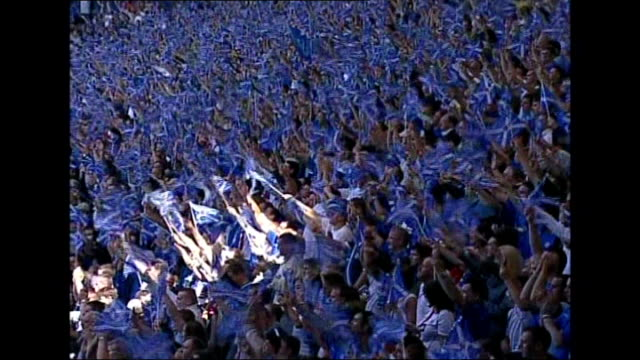 rangers football club goes into liquidation date gv mass rangers fans waving blue st andrews flags in stands sir david murray raising flag on flagpole - liquidation stock videos and b-roll footage