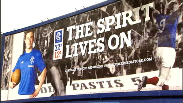 rangers football club goes into liquidation ext rangers poster advertising new football kit 'the spirit lives on' - liquidation stock videos and b-roll footage