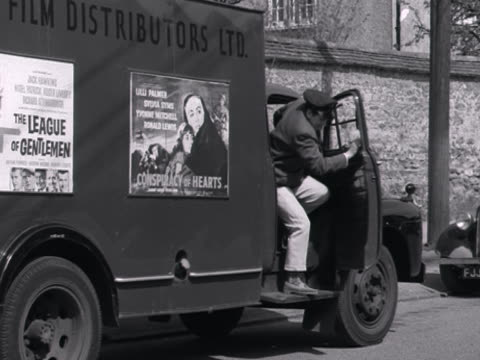 vídeos de stock, filmes e b-roll de a rank distributors van delivers film reels to a cinema - 1960