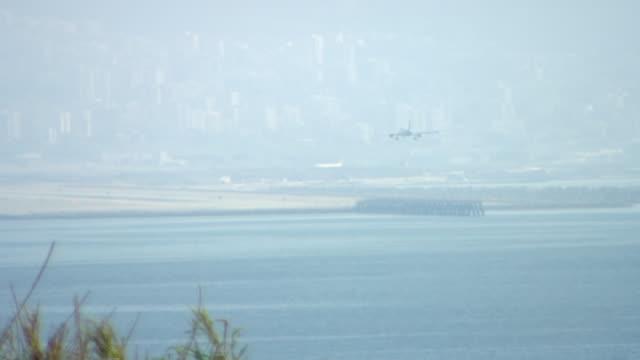 raouche, beirut. airplane approaching and landing at rafic hariri international airport. - mediterranean sea stock videos & royalty-free footage