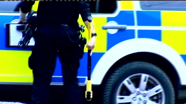 police justify use of taser shotgun; r09071008 england: northumberland: nr morpeth: cragside house: ext police officer carrying taser gun as along to... - moat stock videos & royalty-free footage