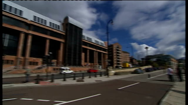 stockvideo's en b-roll-footage met telephone threats by moat played in court newcastleupontyne newcastle crown court day river tyne pan to newcastle crown court 'the law courts' sign... - newcastle upon tyne